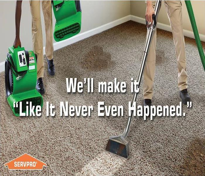 "Two men steam cleaning a dirty carpet with the tagline, We'll make it, ""Like it never even happened."""